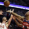 FILE - In this April 17, 2013 file photo, Washington Wizards center Jason Collins, right, battles for a rebound against Chicago Bulls guard Kirk Hinrich during the first half of an NBA basketball game in Chicago. Jason Collins has become the first male professional athlete in the major four American sports leagues to come out as gay. Collins wrote a first-person account posted Monday on Sports Illustrated\'s website. The 34-year-old Collins has played for six NBA teams in 12 seasons. He finished this past season with the Washington Wizards and is now a free agent. He says he wants to continue playing. (AP Photo/Nam Y. Huh, File)