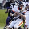 Illinois quarterback Reilly O\'Toole (4) is sacked by Northwestern defensive lineman Quentin Williams (88) during the second half of an NCAA college football game in Evanston, Ill., Saturday, Nov. 24, 2012. Northwestern won 50-14. (AP Photo/Nam Y. Huh)