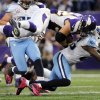 Minnesota Vikings running back Toby Gerhart, top, is tackled by Tennessee Titans safety Jordan Babineaux, right, during the second half of an NFL football game on Sunday, Oct. 7, 2012, in Minneapolis. (AP Photo/Jim Mone)