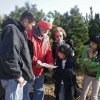 MARTINBIRD TREE FARM / CHRISTMAS TREES: Bob Martin helps a family get started looking for a Christmas tree. Shown are Felix Pham and his daughters Maikhuoung Pham, 7, and Maikha Pham, 12, and Felix Pham\'s sister Kim Campbell. The family chose a balled and burlaped spruce that they\'ll plant after Christmas at their Oklahoma City home.