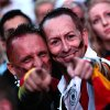 Photo - German fans react as they watch a live broadcast of the final match between Germany and Argentina at the soccer World Cup 2014 in Rio de Janeiro, Brazil, at a public viewing area called 'Fan Mile' in Berlin, Sunday, July 13, 2014. (AP Photo/Markus Schreiber)