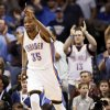 Oklahoma City\'s Kevin Durant (35) reacts after making a shot during the NBA basketball game between the Miami Heat and the Oklahoma City Thunder at Chesapeake Energy Arena in Oklahoma City, Sunday, March 25, 2012. Photo by Nate Billings, The Oklahoman