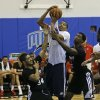 Oklahoma City Thunder\'s Andre Roberson, center, tries to make a shot between Detroit Pistons\' Peyton Siva (34) and Kartavious Caldwell-Pope, right, during an NBA summer league basketball game, Tuesday, July 9, 2013, in Orlando, Fla. (AP Photo/John Raoux) ORG XMIT: DOA113