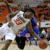 /tou33n/ goes past Texas-Arlington\'s Kevin Butler (24) during a college basketball game between Oklahoma State University and UT Arlington at Gallagher-Iba Arena in Stillwater, Okla., Wednesday, Dec. 19, 2012. Photo by Bryan Terry, The Oklahoman
