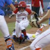 Nebraska\'s Gabby Banda runs home to score past Florida\'s Stephanie Tofft as she drops the ball in the seventh inning of their Women\'s College World Series softball game at ASA Hall of Fame Stadium in Oklahoma City, Saturday, June, 1, 2013. Photo by Bryan Terry, The Oklahoman