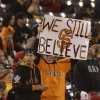 A pair of San Francisco Giants fans hold up a sign in left field during the ninth inning of their baseball game against the New York Mets Tuesday, July 9, 2013, in San Francisco. New York won the game 10-6. (AP Photo/Eric Risberg)