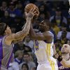 Phoenix Suns\' Michael Beasley, left, and Golden State Warriors\' Festus Ezeli fight for the ball in the first half of an NBA basketball game Saturday, Feb. 2, 2013, in Oakland, Calif. (AP Photo/Ben Margot)
