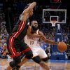Oklahoma City\'s James Harden (13) tries to get past Miami\'s Chris Bosh (1) during Game 2 of the NBA Finals between the Oklahoma City Thunder and the Miami Heat at Chesapeake Energy Arena in Oklahoma City, Thursday, June 14, 2012. Photo by Sarah Phipps, The Oklahoman