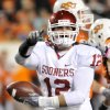 Oklahoma\'s Austin Box points to the OU fans after intercepting a deflected pass against Oklahoma State Saturday November 27, 2010 at Boone Pickens Stadium. (AP Photo/Enid News & Eagle, Billy Hefton)