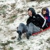 Former Owensboro Catholic High School basketball player Mary Kate Clemens, 19, left, and her younger sister, Sarah Beth Clemens, 11, enjoy the thrill of sledding down the big hill at Chautaqua Park in Owensboro, Ky., on Wednesday morning, Dec. 26, 2012. (AP Photo/The Messenger-Inquirer, Gary Emord-Netzley)