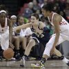 Photo - Maryland guard Laurin Mincy, left, Notre Dame guard Michaela Mabrey, center, and Maryland forward Alyssa Thomas chase after a loose ball in the first half of an NCAA college basketball game in College Park, Md., Monday, Jan. 27, 2014. (AP Photo/Patrick Semansky)