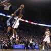 Oklahoma City\'s James Harden (13) is fouled by Denver\'s J.R. Smith (5) during the NBA basketball game between the Denver Nuggets and the Oklahoma City Thunder in the first round of the NBA playoffs at the Oklahoma City Arena, Wednesday, April 27, 2011. Photo by Sarah Phipps, The Oklahoman