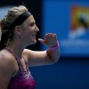 Photo - Victoria Azarenka of Belarus celebrates after defeating Sloane Stephens of the U.S. in their fourth round match at the Australian Open tennis championship in Melbourne, Australia, Monday, Jan. 20, 2014.(AP Photo/Aaron Favila)