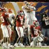 Florida\'s Louis Murphy, left, and Riley Cooper celebrate a touchdown behind OU\'s Lendy Holmes and Dominique Franks during the first half of the BCS National Championship game. Photo by Bryan Terry.