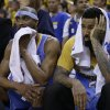 Denver Nuggets\' Corey Brewer, left, and Wilson Chandler watch from the bench during the second half of Game 4 in a first-round NBA basketball playoff series against the Golden State Warriors on Sunday, April 28, 2013, in Oakland, Calif. (AP Photo/Ben Margot)