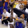 Photo - Indiana Pacers center Roy Hibbert, left, dunks over New York Knicks guard James White during the third quarter of Game 6 of the Eastern Conference semifinal NBA basketball playoff series in Indianapolis, Saturday, May 18, 2013. (AP Photo/Michael Conroy)
