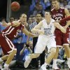 Oklahoma\'s Taylor Griffin (32) and Blake Griffin (23) defend on North Carolina\'s Tyler Hansbrough (50) during the second half in the Elite Eight game of NCAA Men\'s Basketball Regional between the University of North Carolina and the University of Oklahoma at the FedEx Forum on Sunday, March 29, 2009, in Memphis, Tenn. PHOTO BY CHRIS LANDSBERGER, THE OKLAHOMAN