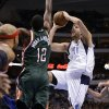 Milwaukee Bucks\' Drew Gooden, Luc Richard Mbah a Moute (12) and Mike Dunleavy (17) defend as Dallas Mavericks\' Dirk Nowitzki (41) shoots in the second half of an NBA basketball game Tuesday, Feb. 26, 2013, in Dallas. The Bucks won 95-90. (AP Photo/Tony Gutierrez)
