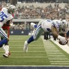 Dallas Cowboys running back DeMarco Murray (29) dives for touchdown while teammate Kevin Ogletree (85) defends against the Tampa Bay Buccanners during the first half of an NFL football game on Sunday, Sept. 23, 2012, Arlington, Texas. (AP Photo/Waco Tribune Herald/ Jose Yau)