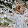 Lucy Baker, 2, keeps cool in high temperatures by playing in a water fountain at the Myriad Gardens in Oklahoma City, Monday, June 25, 2012. Photo by Nate Billings, The Oklahoman