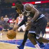 Photo - Orlando Magic's Victor Oladipo, front, and New York Knicks' Carmelo Anthony vie for a loose ball during the first half of an NBA basketball game in Orlando, Fla., Friday, Feb. 21, 2014. (AP Photo/Willie J. Allen Jr.)