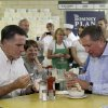 Republican presidential candidate, former Massachusetts Gov. Mitt Romney, eats ice cream with Ohio Gov. John Kasich, Tuesday, Aug. 14, 2012 at Tom\'s ice cream in Zanesville, Ohio. (AP Photo/Mary Altaffer)