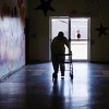 Resident Kay Rick uses a walker to make her way across the gymnasium/multi-purpose room at the 54-bed facility, Center of Family Love, a group home for mentally disabled people, in Okarche on Monday, Jan. 18, 2010. Photo by Jim Beckel, The Oklahoman