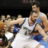 Photo -   Minnesota Timberwolves' Kevin Love (42) drives around Denver Nuggets' Danilo Gallinari, of Italy, in the second half of an NBA basketball game on Wednesday, Nov. 21, 2012, in Minneapolis. The Nuggets won 101-94. Love, making his first start of the regular season following a broken hand, scored 34 points and had 14 rebounds. Gallinari led the Nuggets with 19 points. (AP Photo/Jim Mone)