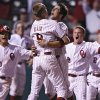 Oklahoma\'s Tyler Ogle (35) reacts with teammate Danny Black (9) after Ogle\'s game-winning score during the bottom of the ninth inning in the Sooners\' 3-2 win in the fourth game of the Big 12 Baseball Championship between Oklahoma and Kansas at the AT&T Bricktown Ballpark on Wednesday, May 26, 2010, in Oklahoma City, Okla. Photo by Chris Landsberger, The Oklahoman