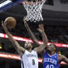 Brooklyn Nets\' Deron Williams (8) drives to the basket and is fouled by Philadelphia 76ers\' Jarvis Varnado during the first half of an NBA basketball game on Saturday, April 5, 2014, in Philadelphia. (AP Photo/Michael Perez)