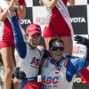 Takuma Sato, left, of Japan, celebrates his victory in the IndyCar Series Grand Prix of Long Beach auto race, Sunday, April 21, 2013, in Long Beach, Calif. Sato became the first Japanese driver to win an IndyCar race. (AP Photo/Ringo H.W. Chiu)