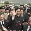 Photo -   Pakistani Prime Minister Yousuf Raza Gilani, center, makes his way to the Supreme Court for a hearing in Islamabad, Pakistan, Thursday, April 26, 2012. The Supreme Court convicted Gilani of contempt on Thursday for refusing to reopen an old corruption case against President Asif Ali Zardari on Thursday, but spared him a prison term in a case that has stoked political tensions in the country. (AP Photo/B.K. Bangash)