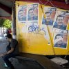 A man sits next to posters with images of Venezuela President Hugo Chavez in Caracas, Venezuela, Thursday, Jan. 3, 2013. The ailing president\'s health crisis has raised contentious questions ahead of the swearing-in set for Jan. 10, including whether the inauguration could legally be postponed. Officials have raised the possibility that Chavez might not be well enough to take the oath of office, without saying what will happen if he can\'t. The constitution says that if a president or president-elect dies or is declared unable to continue in office, presidential powers should be held temporarily by the president of the National Assembly and that a new presidential vote should be held within 30 days. (AP Photo/Ariana Cubillos)