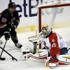 Florida Panthers goalie Dan Ellis (39) is unable to block Carolina Hurricanes\' Patrick Dwyer (39) who assists on the Hurricanes\' third goal during the second period of an NHL hockey game in Sunrise, Fla., Thursday, March 27, 2014. (AP Photo/J Pat Carter)