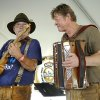 """Duck"" Harris plays guitar and Ronni Tippel plays the accordion as they and other members of the band, Walburg Boys, entertain the afternoon crowd at Oktoberfest last year. Photo by Jim Beckel, The Oklahoman. Jim Beckel -"
