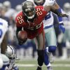 Tampa Bay Buccaneers cornerback Aqib Talib (25) tumbles to the ground after intercepting a pass by Dallas Cowboys quarterback Tony Romo away during the first half of an NFL football game on Sunday, Sept. 23, 2012, in Arlington, Texas. (AP Photo/LM Otero)