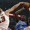 Chicago Bulls center Joakim Noah (13) blocks the shot of Oklahoma City Thunder center Kendrick Perkins during the first half of an NBA preseason basketball gam, Tuesday, Oct. 23, 2012, in Chicago. (AP Photo/Charles Rex Arbogast) ORG XMIT: CXA104