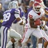 Oklahoma Sooners\' Roy Finch (22) runs past Kansas State Wildcats\' Matthew Pearson (38) during the college football game between the University of Oklahoma Sooners (OU) and the Kansas State University Wildcats (KSU) at Bill Snyder Family Stadium on Saturday, Oct. 29, 2011. in Manhattan, Kan. Photo by Chris Landsberger, The Oklahoman ORG XMIT: KOD