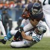Photo -   Chicago Bears running back Matt Forte is tackled by Carolina Panthers linebacker Luke Kuechly (59) during the second half of an NFL football game in Chicago, Sunday, Oct. 28, 2012. The Bears won 23-22. (AP Photo/Nam Y. Huh)