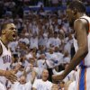 Photo -  Oklahoma City Thunder's Russell Westbrook (0) and Kevin Durant (35) celebrate during the first half of Game 6 against the San Antonio Spurs in the Western Conference finals NBA basketball playoff series in Oklahoma City, Saturday, May 31, 2014. (AP Photo/Sue Ogrocki)