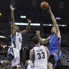 Oklahoma City Thunder forward Nick Collison (4) drives against Memphis Grizzlies center Marc Gasol (33), of Spain, and Darrell Arthur (00) during the first half of Game 4 of a second-round NBA basketball playoff series on Monday, May 9, 2011, in Memphis, Tenn. (AP Photo/Lance Murphey)