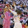 Photo - Kentucky guard Jennifer O'Neill (0) shoots over Tennessee guard Meighan Simmons in the second half of an NCAA college basketball game on Sunday, Feb. 16, 2014, in Knoxville, Tenn. Kentucky won 75-71. (AP Photo/Wade Payne)