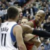 Miami Heat\'s Ray Allen, right, is separated by a teammate and an official is he jaws with Minnesota Timberwolves\' J.J. Barea in the second half of an NBA basketball game Monday, March 4, 2013, in Minneapolis. Barea was ejected after a flagrant foul was called on him. The Heat won 97-81. (AP Photo/Jim Mone)