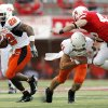 OSU\'s Dantrell Savage (22) carries the ball as quarterback Zac Robinson (11) blocks Nebraska\'s Ben Eisenhart (46) in the second quarter during the college football game between Oklahoma State University (OSU) and the University of Nebraska (NU) at Memorial Stadium in Lincoln, Neb., Saturday, October 13, 2007. By Nate Billings, The Oklahoman
