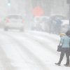 Pedestrians support each other as they cross S. Elm St. during a snow storm, Wednesday, Feb. 12, 2014 in Greensboro, N.C. As a third winter storm in as many days slammed into North Carolina, commutes that typically took minutes turned into hours-long ordeals. The National Weather Service issued a winter storm warning lasting into Thursday covering 95 of the state\'s 100 counties. (AP Photo/News & Record, Jerry Wolford)