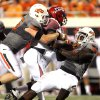 Oklahoma State\'s Caleb Lavey, left, and Anthony Rogers sack Louisiana-Lafayette\'s Blaine Gautier during the second half of the game Saturday. Photo by Sarah Phipps, The Oklahoman