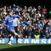 Photo - Chelsea's Eden Hazard scores his team's third goal from the penalty spot during their English Premier League soccer match between Chelsea and Arsenal at Stamford Bridge stadium in London Saturday, March,  22  2014. (AP Photo/Alastair Grant)