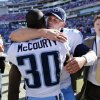 Photo -   Tennessee Titans quarterback Jake Locker, right, hugs cornerback Jason McCourty (30) after defeating the Detroit Lions 44-41 in overtime at an NFL football game on Sunday, Sept. 23, 2012, in Nashville, Tenn. (AP Photo/Joe Howell)