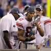 New York Giants wide receiver Victor Cruz kisses the Vince Lombardi Trophy after the NFL Super Bowl XLVI football game against the New England Patriots, Sunday, Feb. 5, 2012, in Indianapolis. (AP Photo/David Duprey) ORG XMIT: SB526