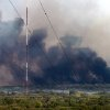 White, gray and black smoke dominate the horizon as a large wildfire burns out of control near NE 63 and Sooner Road in northeast Oklahoma County, Tuesday afternoon, Aug. 30, 2011, Photo by Jim Beckel, The Oklahoman